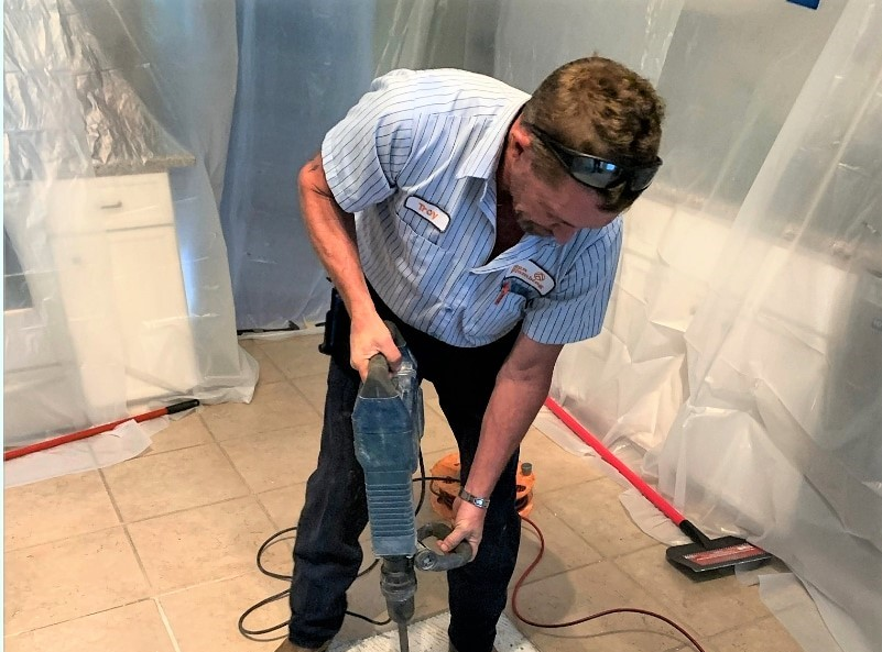 Plumber from Sun Plumbing fixing a slab leak
