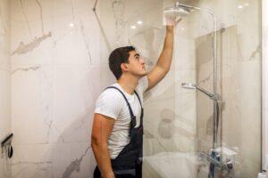 plumber checking shower head