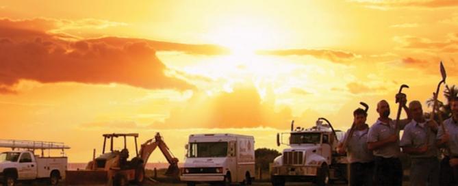 Sun Plumbing trucks sunset background